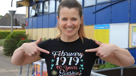 Forty and fabulous: Sheringham carnival queen Emma Taylor sporting a tee shirt emblazoned with her y