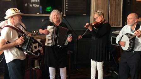 Five shades of grey performing at the Albion during the Cromer folk festival. Picture: Ella Wilkinso