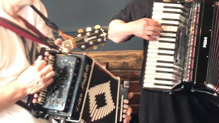 Five shdes of grey playing two accordions at the Cromer Folk Festival. Picture: Ella Wilkinson