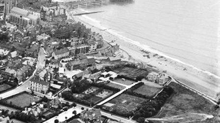 An aerial photo taken before 1920 – when the lifeboat house was added to the pier – showing the fiel