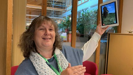 North Norfolk District Council leader Sarahm Butikofer shows off the new Deep History Coast app. Pic