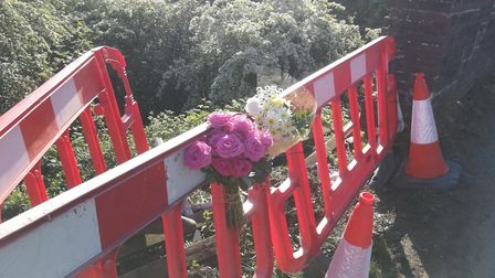 Floral tributes were left at the scene of the fatal accident on the B1145 at Cawston, Norfolk. Pictu