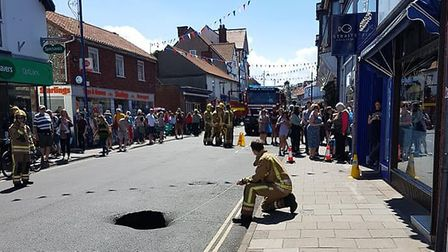 A sink hole has opened up in Sheringham's High Street. Picture: LIZ WITHINGTON