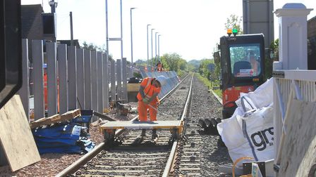 Platform works at Sheringham station are now complete. Pictured, workers installing a new 80-metre p