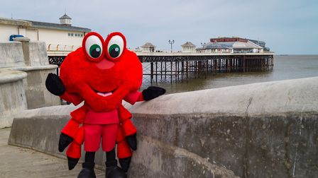 Cromer Piers Claude the Crab will cut the ribbon at the new EACH charity shop in the town's Tucker S