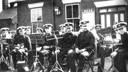 The Stalham Brass Band performing in front of Stalham Railway Station, ninety years ago. Pictures: s