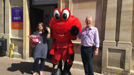 Cromer Pier mascot Claude the Crab with store manager Laura Mackay and area manager David Loombe, at