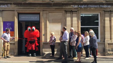 Cromer Pier mascot Claude the Crab cuts the ribbon at the new EACH charity shop on Tucker Street. Ph