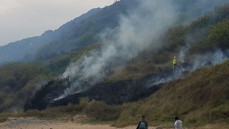 A fire broke out on the cliffs near Cromer Lighthouse. Picture: FRAN WHITING