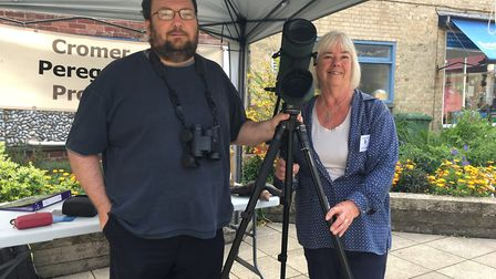 Andrew Gorton and Ann Cleall of the North East Norfolk Bird club watching baby peregrines hatching.