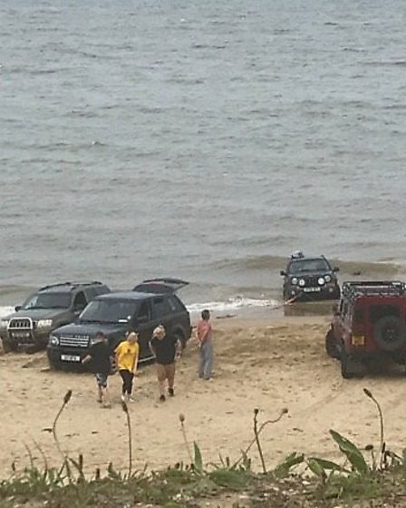 Vehicles had to be towed off the beach in Trimingham in Norfolk after being caught out by the rising