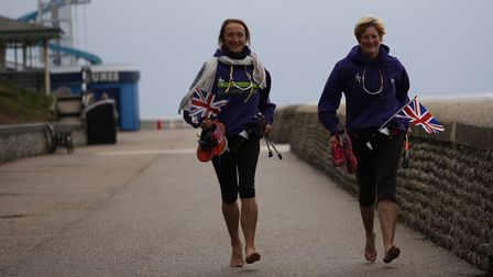 Anita Lusher and Sally King finishing their 52 miles in a day walking challenge at Cromer Pie in 201