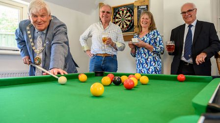 Tunstead Horse and Groom gets new cafe and games room. District council chairman Clive Stockton trie