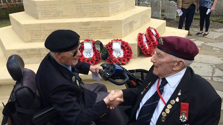 D-Day veterans George Gallagher, left, and Len Mann meet up for first time at service. Pictures: Dav