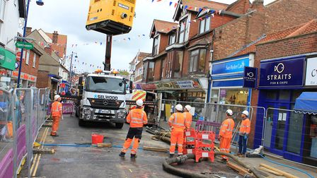 Engineers working on the sinkhole in Sheringham High Street.Picture: KAREN BETHELL