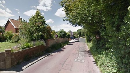 The fire service were called to Weybourne after a car crashed into a house on Sheringham Road. Photo