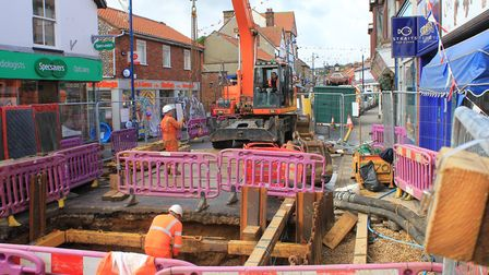 Engineers are digging eight metres underground to repair a damaged sewage pipe below the Sheringham