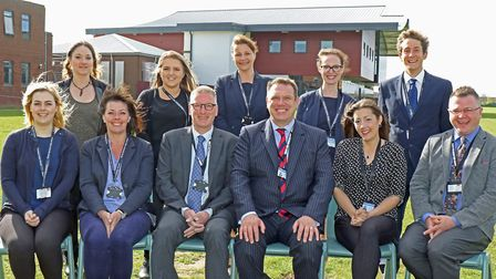 Headteacher Neil Powell, front centre right, with other staff at North Walsham High School. He has p