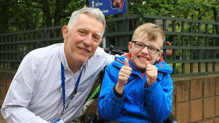 Nine-year-old Ben Taylor with Sheringham Primary School music teacher Jon Cooper, who is setting off