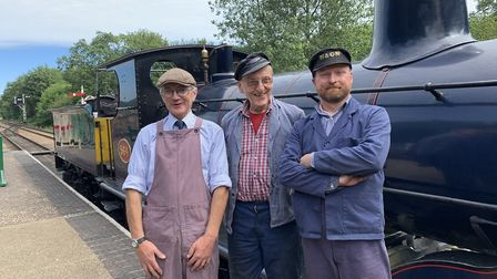 From left, Paul O'Brien, James Quinlan and Ray Webb in front of the Class Y14 locomotive on the Nort