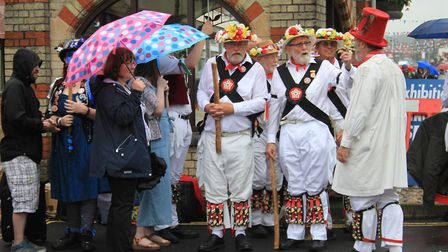 Dancers sheltering from the rain at the Potty Morris and Folk Festival.Picture: KAREN BETHELL