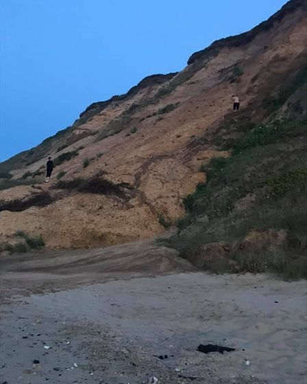 Two people were seen walking on the cliffs at the site of a recent cliff fall at Mundesley in Norfol