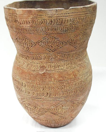 A Broze Age beaker. Beakers were often placed at burial sites such as barrows 'alongside their grand