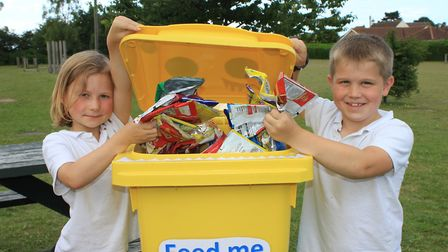 Sheringham Primary School pupils Ivy and Lucas with one of the bright yellow Terracycle bins being