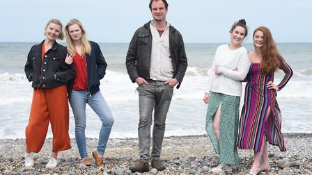 Alex Joseph, writer and director, with the cast for his film, Wrecking Ball, being filmed in Cromer.