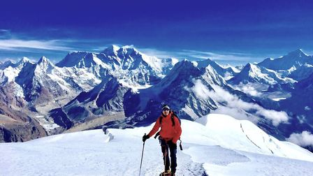 Philip Nolan, a few metres away from the summit of Mera Peak. Everest in the background over his rig
