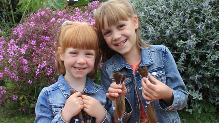 Sisters Pollyanna and Amelia Williams, who have donated more than two feet of their hair and raised
