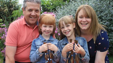 Six-year-old Pollyanna Williams (left) and and her sister Amelia, 8, with their proud parents Matthe