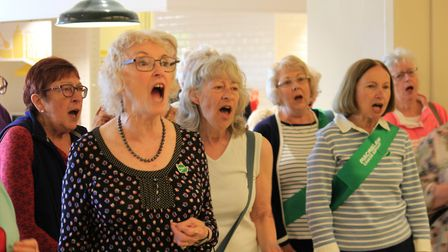 The New Sheringham Singers giving a 'flashmob' performance of Show Me the Way to Amarillo at Morriso