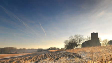 A frost covered field in front of Corpusty church.PHOTO: ANTONY KELLY