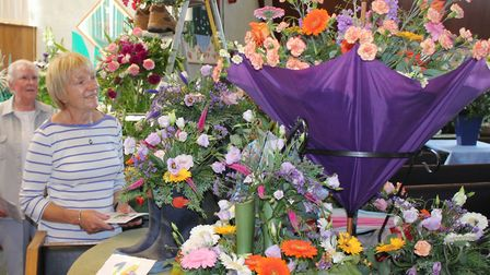 An flower-filled umbrella at St Andrew's Church flower festival, which features arrangements on the