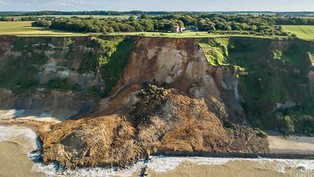 Sidestrand Hall school is just above the cliffs in this picture showing debris left in the aftermath