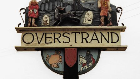 The original village sign at Overstrand, which was created by prolific village sign creator Harry Ca