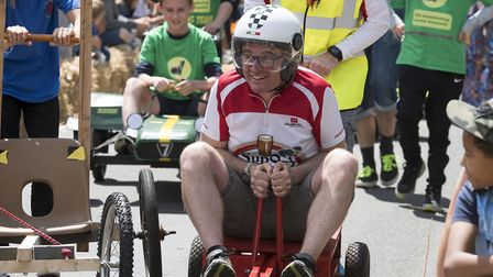 Competitors race to the finish line at Mundesley Soapbox Derby, which runs on July 20. Picture: JON