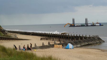 Sandscaping preparations near Bacton Gas Terminal, while holidaymakers enjoy the beach. Pictures: M