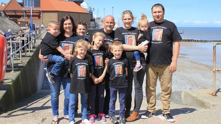 Five-year-old Benny Pitcher (left), his mum Julie, dad, Kevin, and siblings Ruby, 10, Brannigan, 12
