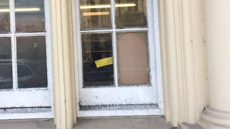 A window was smashed at the Royal Mail enquiry office. Picture: David Bale