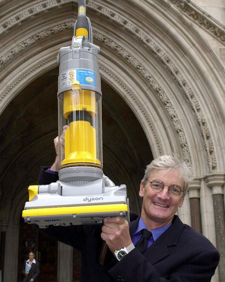 Sir James Dyson with one of his iconic bagless vacuum cleaners. Picture: PA/Kirsty Wigglesworth