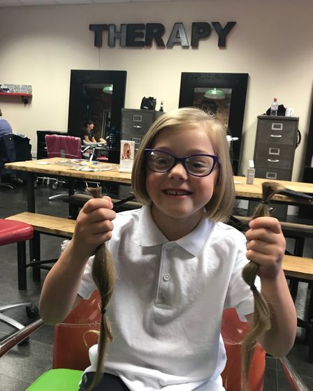 Niamh Everett, six, from Aylsham, who had her hair cut for charity. Picture: Supplied by Elly Everet