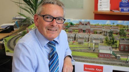 Sheringham estate agent Clive Hedges with the model village he has been asked to sell.Picture: KAREN