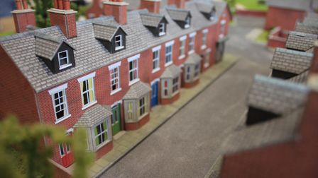 A row of terraced cottages featured in the model village on sale at Norfolk estate agents Keys Arnol