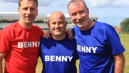 Canaries legends Darren Eadie and Mike Milligan with Kevin Pitcher, whose five-year-old son Benny ha