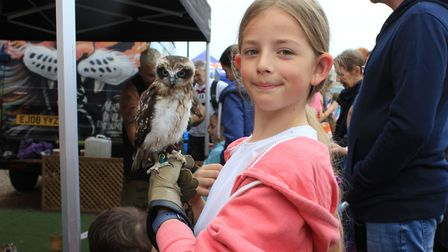 Nine-year-old Lily Croton with Peeka the Boobook owl, who was brought along to Cromer Lifeboat Day b