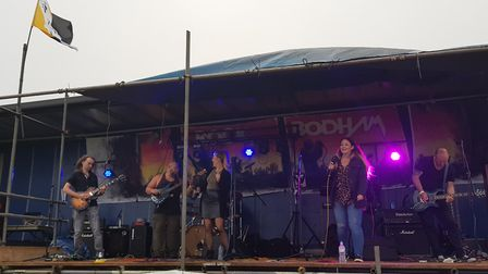 The Norfolk flag is flown as ultra ego perform at Rock Bodham on Norfolk Day. Photograph: Jonathon R