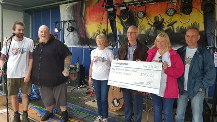 Dr Tony Page of the Norfolk Heart Trust accepts a cheque from the organisers of Rock Bodham. Picture