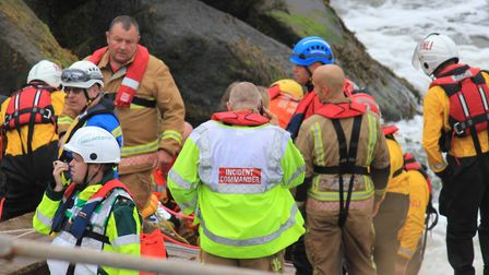 Emergency services working to free a man stuck in rocks on Sheringham seafront.Picture: KAREN BETHEL